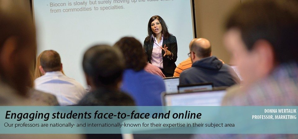 Engaging students face-to-face and online: our professors are   nationally - and internationally - known for their expertise in their subject area. Photo of Donna Wertalik, Marketing professor, teaching a class.""